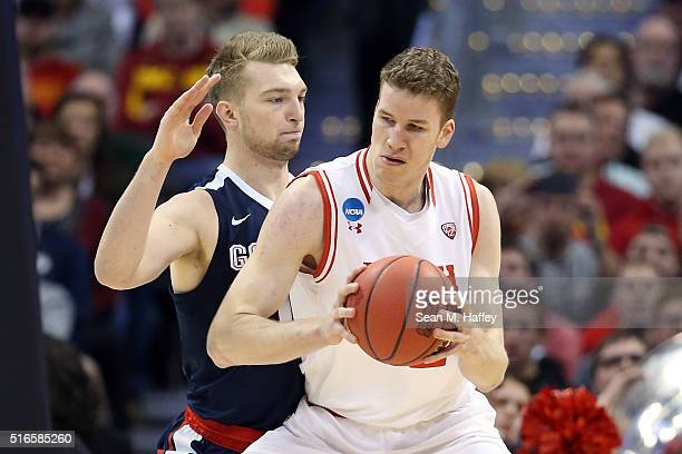 Jakob Poeltl of the Utah Utes drives the ball against Domantas Sabonis of the Gonzaga Bulldogs during the second round of the 2016 NCAA Men's...