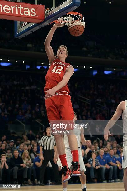 Jakob Poeltl of the Utah Utes dunks against the Duke Blue Devils during the Ameritas Insurance Classic at Madison Square Garden on December 19 2015...