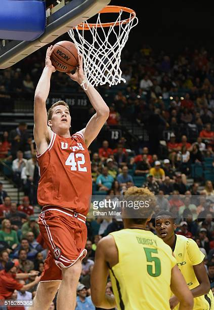 Jakob Poeltl of the Utah Utes goes in for a dunk against Tyler Dorsey of the Oregon Ducks during the championship game of the Pac12 Basketball...