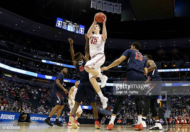 Jakob Poeltl of the Utah Utes goes up against the Fresno State Bulldogs in the first half during the first round of the 2016 NCAA Men's Basketball...