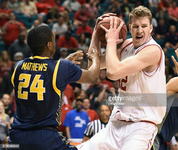Jakob Poeltl of the Utah Utes grabs a rebound against Jordan Mathews of the California Golden Bears during a semifinal game of the Pac12 Basketball...