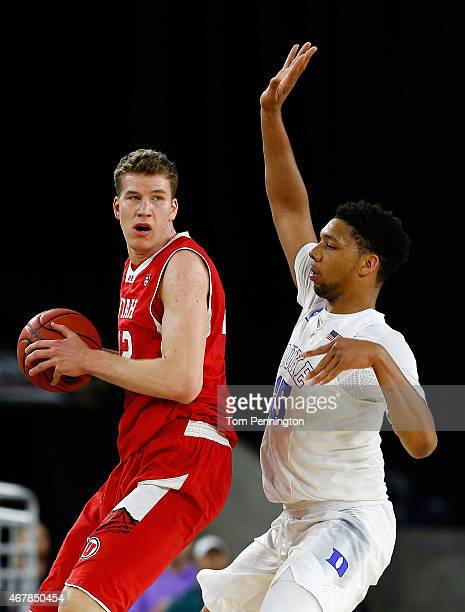Jakob Poeltl of the Utah Utes looks to pass as Jahlil Okafor of the Duke Blue Devils defends during a South Regional Semifinal game of the 2015 NCAA...