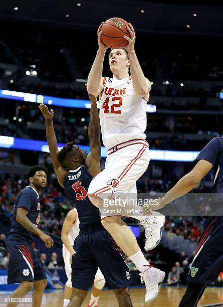 Jakob Poeltl of the Utah Utes shoots against Jahmel Taylor of the Fresno State Bulldogs in the first half during the first round of the 2016 NCAA...
