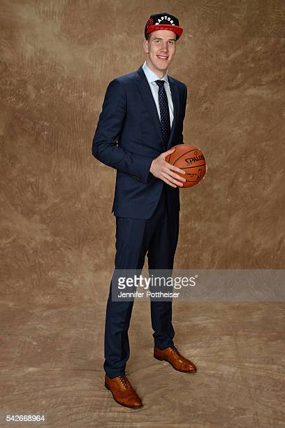Jakob Poeltl poses for a portrait after being drafted number nine overall to the Toronto Raptors during the 2016 NBA Draft on June 23 2016 at...