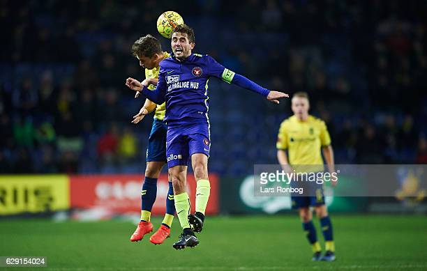 Jakob Poulsen of FC Midtjylland and Andrew Hjulsager of Brondby IF compete for the ball during the Danish Alka Superliga match between Brondby IF and...
