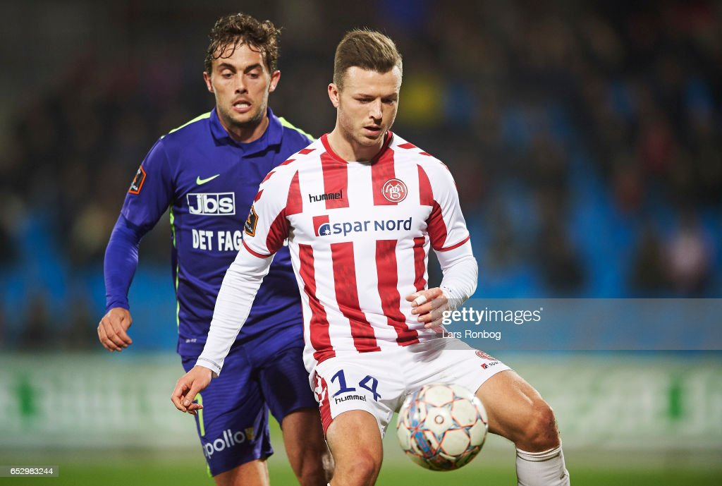 Jakob Poulsen of FC Midtjylland and Casper Sloth of AaB Aalborg compete for the ball during the Danish Alka Superliga match between AaB Aalborg and FC Midtjylland at Aalborg Portland Park on March 13, 2017 in Aalborg, Denmark.