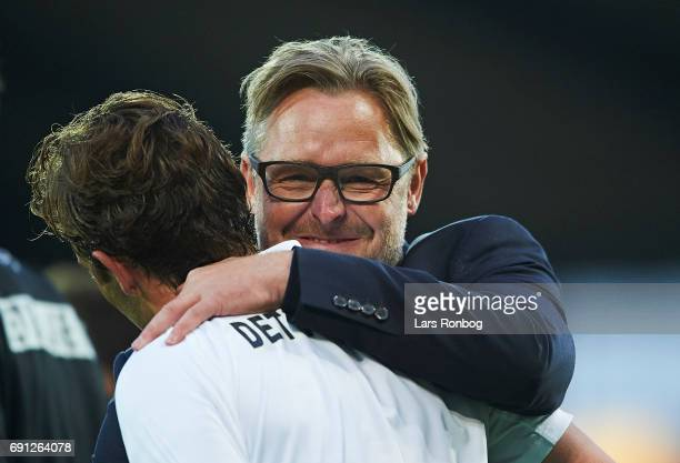 Jakob Poulsen of FC Midtjylland and Claus Steinlein sports director of FC Midtjylland celebrate after celebrates after the Danish Alka Superliga...