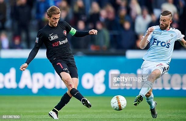 Jakob Poulsen of FC Midtjylland and Janus Drachmann of Sonderjyske compete for the ball during the Danish Alka Superliga match between FC Midtjylland...