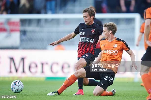 Jakob Poulsen of FC Midtjylland and Kasper Enghardt of Randers FC compete for the ball during the Danish Alka Superliga Europa League Playoff match...