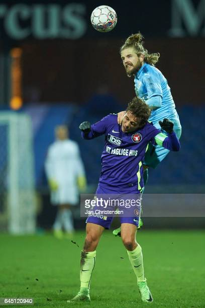 Jakob Poulsen of FC Midtjylland and Kasper Fisker of Randers FC compete for the ball during the Danish Alka Superliga match between Randers FC and FC...