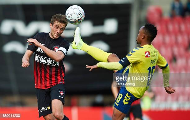 Jakob Poulsen of FC Midtjylland and Lebogang Phiri of Brondby IF compete for the ball during the Danish Alka Superliga match between FC Midtjylland...