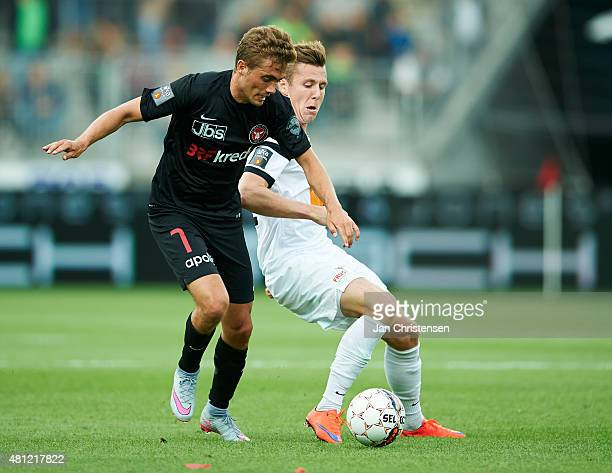 Jakob Poulsen of FC Midtjylland and Lukas Lerager of Viborg FF compete for the ball during the Danish Alka Superliga match between FC Midtjylland and...