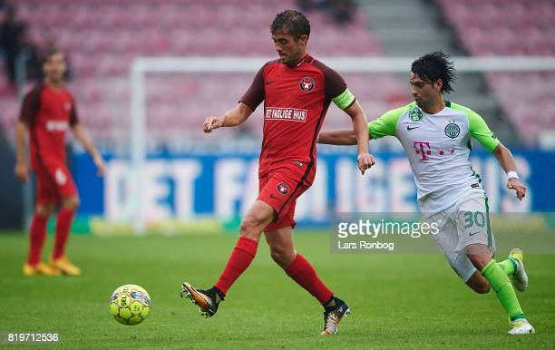 Jakob Poulsen of FC Midtjylland and Rui Pedro of Ferencvarosi TC compete for the ball during the UEFA Europa League Qualification match between FC...