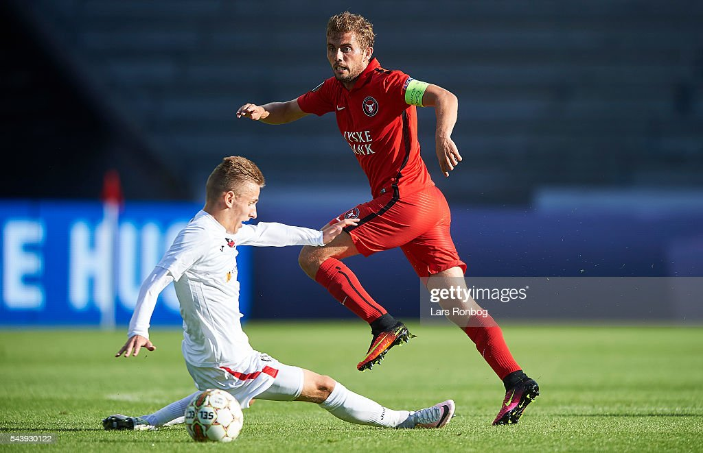 <a gi-track='captionPersonalityLinkClicked' href=/galleries/search?phrase=Jakob+Poulsen&family=editorial&specificpeople=844439 ng-click='$event.stopPropagation()'>Jakob Poulsen</a> of FC Midtjylland in action during the Europa League Qualifier match between FC Midtjylland and FK Suduva at MCH Arena on June 30, 2016 in Herning, Denmark.