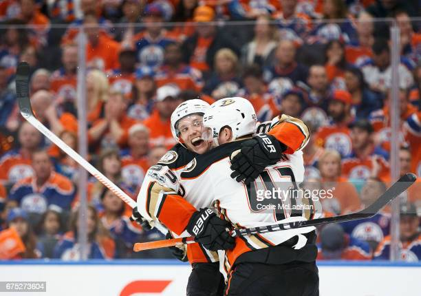 Jakob Silfverberg and Josh Manson of the Anaheim Ducks celebrate Silfverberg's goal against the Edmonton Oilers in Game Three of the Western...
