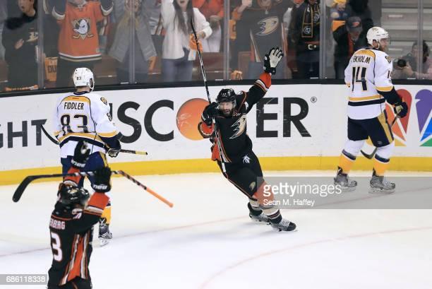 Jakob Silfverberg and Ryan Kesler of the Anaheim Ducks celebrate teammate Chris Wagner's goal as Mattias Ekholm and Vernon Fiddler of the Nashville...