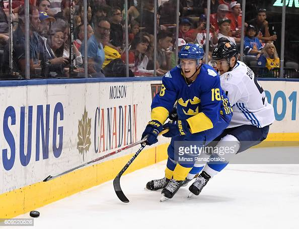 Jakob Silfverberg of Team Sweden and Aleksander Barkov of Team Finland battle for a loose puck during the World Cup of Hockey 2016 at Air Canada...