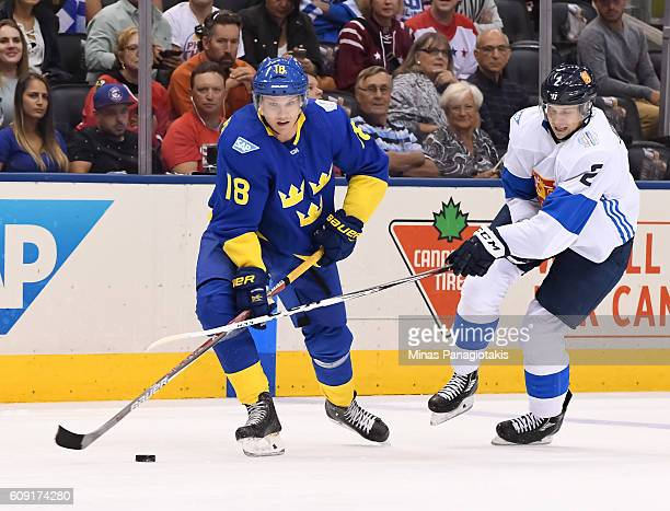 Jakob Silfverberg of Team Sweden stickhandles the puck with Jyrki Jokipakka of Team Finland chasing during the World Cup of Hockey 2016 at Air Canada...