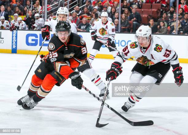 Jakob Silfverberg of the Anaheim Ducks and Brian Campbell of the Chicago Blackhawks race for the puck during the third period of the game at Honda...