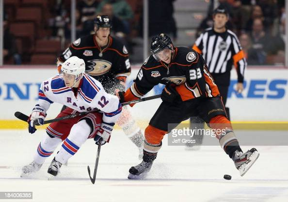 Jakob Silfverberg of the Anaheim Ducks and Jesper Fast of the New York Rangers get tangled up while pursuing the puck in the third period at Honda...