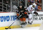 Jakob Silfverberg of the Anaheim Ducks and Johnny Oduya of the Chicago Blackhawks collide at the boards in the third period of Game Two of the...