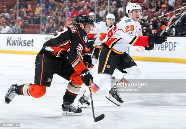 Jakob Silfverberg of the Anaheim Ducks and Michael Stone of the Calgary Flames pursue a puck during the first period of the game at Honda Center on...