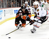 Jakob Silfverberg of the Anaheim Ducks and Niklas Hjalmarsson of the Chicago Blackhawks go after the puck in the first period in Game Seven of the...