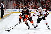 Jakob Silfverberg of the Anaheim Ducks and Teuvo Teravainen of the Chicago Blackhawks go after the puck in the first period in Game Seven of the...