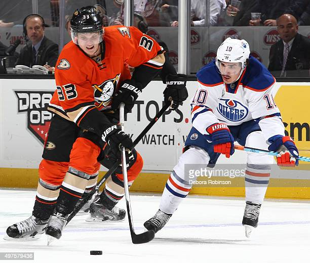 Jakob Silfverberg of the Anaheim Ducks battles for the puck against Nail Yakupov of the Edmonton Oilers on November 11 2015 at Honda Center in...