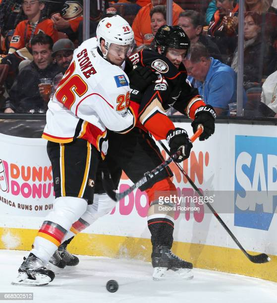 Jakob Silfverberg of the Anaheim Ducks battles for the puck against Michael Stone of the Calgary Flames in Game One of the Western Conference First...