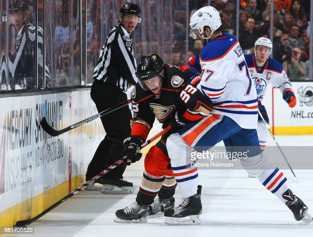 Jakob Silfverberg of the Anaheim Ducks battles for the puck against Oscar Klefbom of the Edmonton Oilers in Game Seven of the Western Conference...