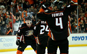 Jakob Silfverberg of the Anaheim Ducks celebrates with Simon Despres and Cam Fowler#4 after scoring the game winning goal with 19 seconds left in the...