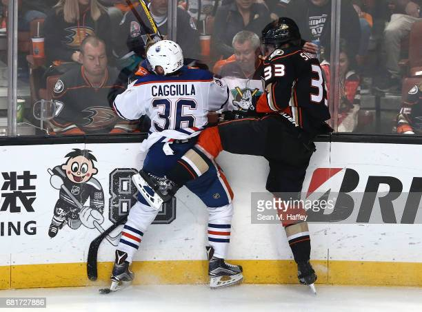 Jakob Silfverberg of the Anaheim Ducks checks Drake Caggiula of the Edmonton Oilers in Game Seven of the Western Conference Second Round during the...