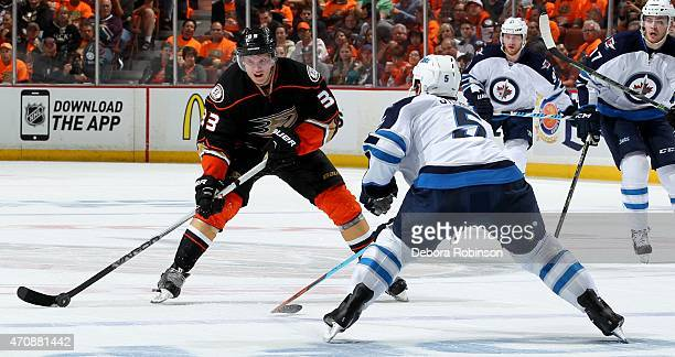 Jakob Silfverberg of the Anaheim Ducks handles the puck against Mark Stuart of the Winnipeg Jets in Game One of the Western Conference Quarterfinals...