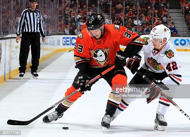 Jakob Silfverberg of the Anaheim Ducks handles the puck against Gustav Forsling of the Chicago Blackhawks on November 25 2016 at Honda Center in...