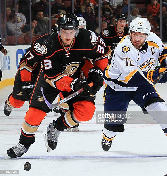 Jakob Silfverberg of the Anaheim Ducks races for the puck with pressure from Mike Fisher of the Nashville Predators on October 26 2016 at Honda...