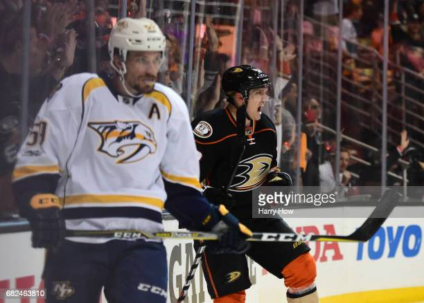 Jakob Silfverberg of the Anaheim Ducks reacts after scoring a goal in the first period as Roman Josi of the Nashville Predators looks on during Game...