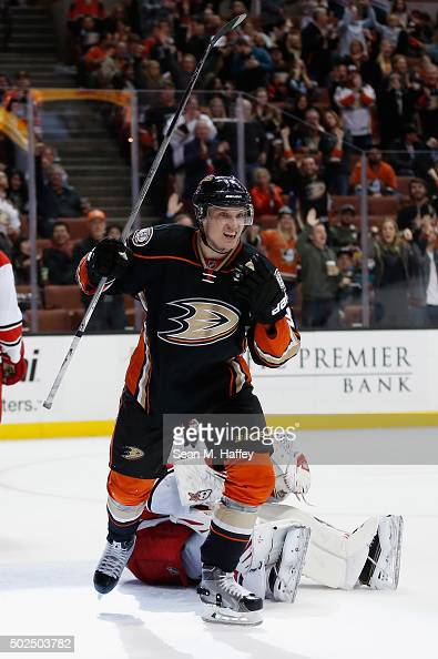 Jakob Silfverberg of the Anaheim Ducks reacts to scoring a goal as Eddie Lack of the Carolina Hurricanes looks on during the third period of a game...