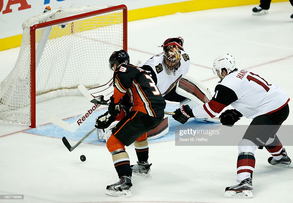 Jakob Silfverberg #33 of the Anaheim Ducks shoots as Mike Smith #41 of the Arizona Coyotes and Martin Hanzal #11 of the Arizona Coyotes defend during the third period of a game at Honda Center on October 14, 2015 in Anaheim, California.
