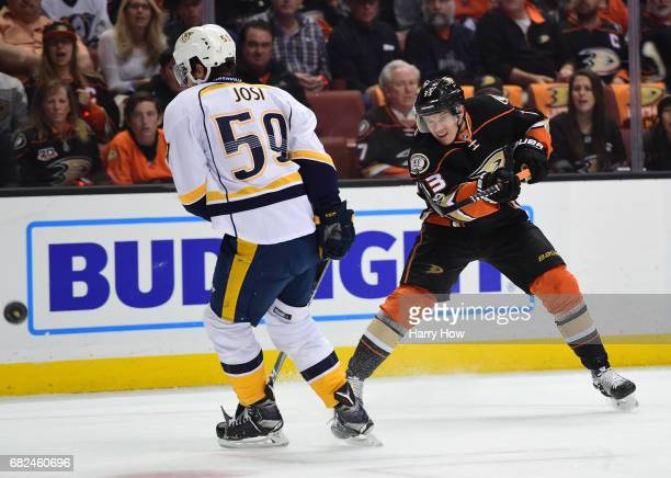 Jakob Silfverberg of the Anaheim Ducks shoots from the right wing past Roman Josi of the Nashville Predators for a goal in the first period of Game...
