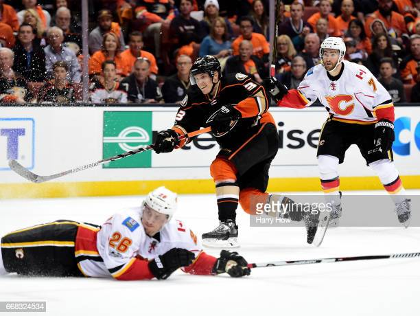 Jakob Silfverberg of the Anaheim Ducks shoots over a sliding Michael Stone of the Calgary Flames during a 32 Ducks win in Game One of the Western...