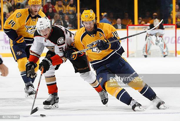 Jakob Silfverberg of the Anaheim Ducks skates against James Neal of the Nashville Predators during an NHL game at Bridgestone Arena on November 12...