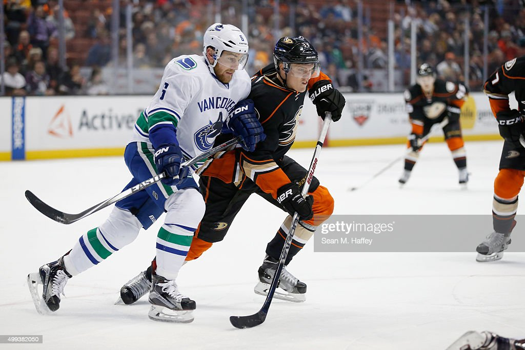 Jakob Silfverberg #33 of the Anaheim Ducks skates against Yannick Weber #6 of the Vancouver Canucks during the first period of a game at Honda Center on November 30, 2015 in Anaheim, California.
