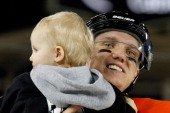 Jakob Silfverberg of the Anaheim Ducks skates with his daughter during the family skate following team practice for the 2014 Coors Light NHL Stadium...