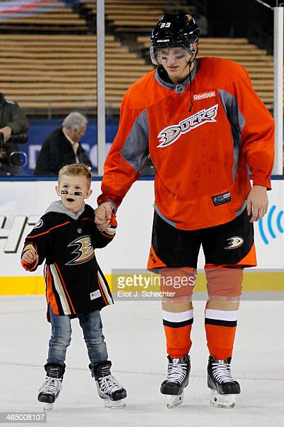 Jakob Silfverberg of the Anaheim Ducks skates with his son during the family skate following team practice for the 2014 Coors Light NHL Stadium...
