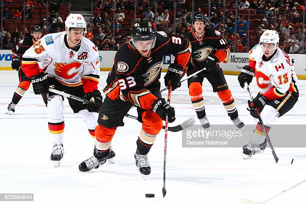 Jakob Silfverberg of the Anaheim Ducks skates with the puck against Sean Monahan and Johnny Gaudreau of the Calgary Flames on November 6 2016 at...