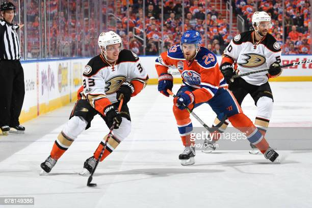 Jakob Silfverberg of the Anaheim Ducks skates with the puck while being pursued by Leon Draisaitl of the Edmonton Oilers in Game Four of the Western...