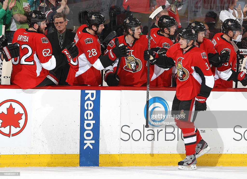 Jakob Silfverberg #33 of the Ottawa Senators celebrates a first period goal with team mates on the bench, during an NHL game against the Winnipeg Jets, at Scotiabank Place, on March 17, 2013 in Ottawa, Ontario, Canada.