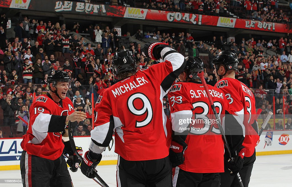 Jakob Silfverberg #33 of the Ottawa Senators celebrates his first career NHL goal in a game against the Florida Panthers with teammates <a gi-track='captionPersonalityLinkClicked' href=/galleries/search?phrase=Jason+Spezza&family=editorial&specificpeople=202023 ng-click='$event.stopPropagation()'>Jason Spezza</a> #19, <a gi-track='captionPersonalityLinkClicked' href=/galleries/search?phrase=Milan+Michalek&family=editorial&specificpeople=544987 ng-click='$event.stopPropagation()'>Milan Michalek</a> #9 and <a gi-track='captionPersonalityLinkClicked' href=/galleries/search?phrase=Marc+Methot&family=editorial&specificpeople=2216900 ng-click='$event.stopPropagation()'>Marc Methot</a> #3 on January 21, 2013 at Scotiabank Place in Ottawa, Ontario, Canada.