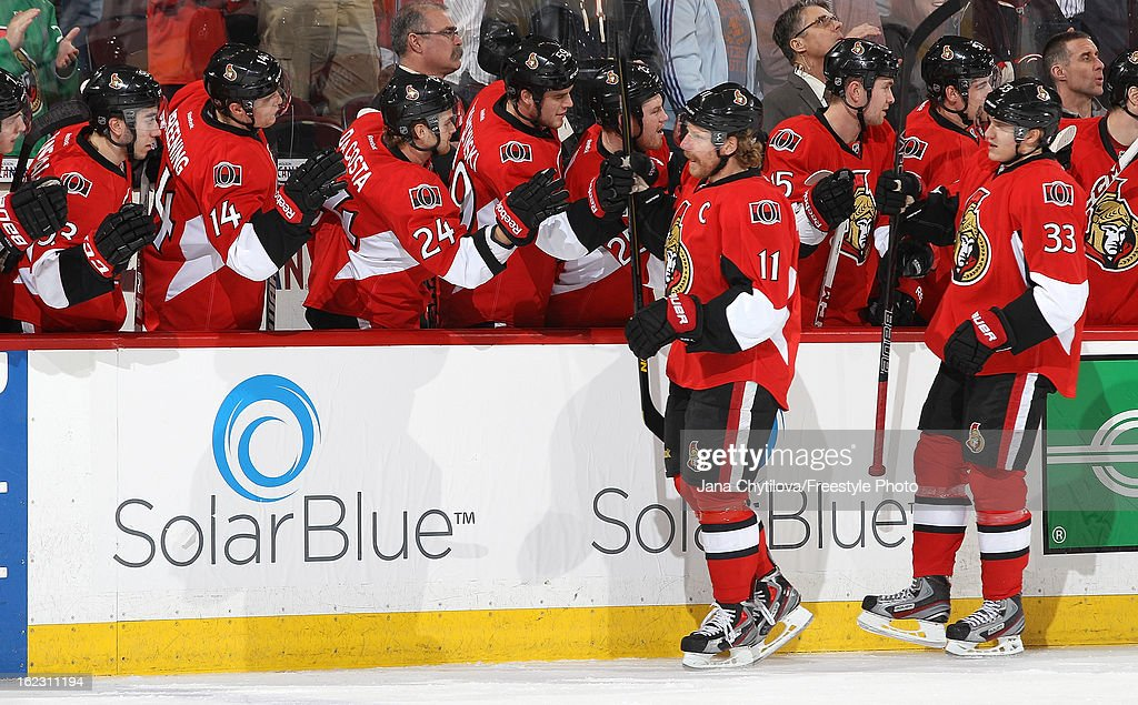 Jakob Silfverberg #33 of the Ottawa Senators celebrates his first period short-handed goal with line mate Daniel Alfredsson #11 and with members on the bench, during an NHL game against the New York Rangers, at Scotiabank Place on February 21, 2013 in Ottawa, Ontario, Canada.